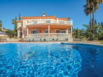 Photo for Elegant villa near the airport w/ manicured gardens, bbq and pool