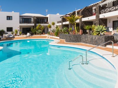 Photo for Beautiful Apartment with Patio, Pool, and Wi-Fi; Short Walk from Beach