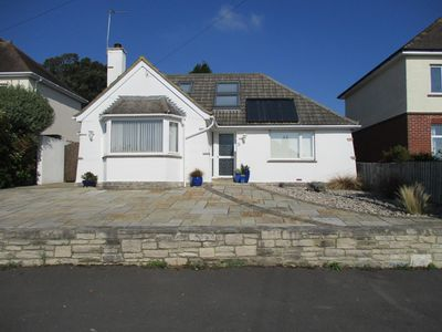 Photo for Chalet Bungalow Sleeps 8 In A Quiet Residential Road In North Swanage.