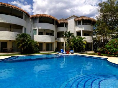Photo for Superb location.  Brand new condo.  Close to beach and shopping!
