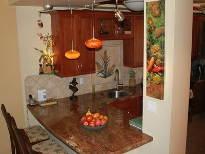 Mosaic Granite Pineapple greets you in spectacular custom kitchen