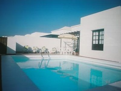 Photo for - Luxury Villa Private Heated Pool, Internet.No car required. Quiet location