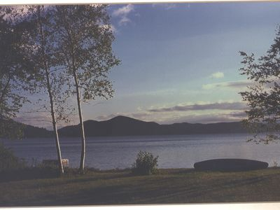 Photo for Rustic cottage with beautiful sandy beach right on Lake George