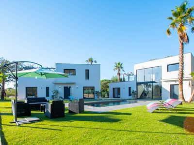 Photo for Two magnificent villas with a swimming pool, garden & central AC!