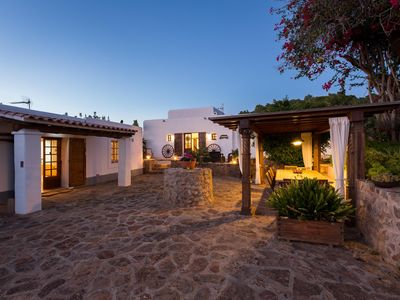 Photo for Holiday Villa (Up to 14 people): Two secluded old farm houses beatifully restored (rented as one). Private Multisport court, pool - Santa Eulalia del Rio
