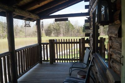 Front porch where you will enjoy feeding the catfish and watching aquatic life.