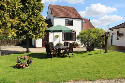 The cottage is set in lovely gardens with a picnic table provided.