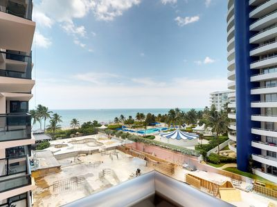 Photo for Oceanfront condo offers beautiful views, a shared pool, nearby beach, and more!