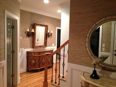 Entry foyer with elevator and stairs