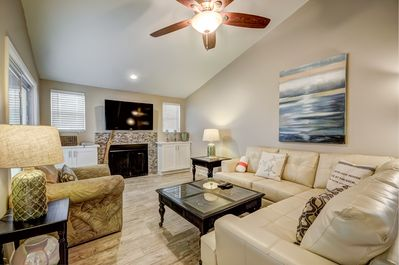Watch a movie or your favorite show or sporting event on the large LCD TV/DVD/VCR.Relax in the cozy living room complete with fireplace on the comfy sectional sofa that's big enough for the family to curl up on together.