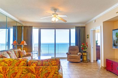 The great room has a tropical queen sleeper sofa and love seat, a leather recliner and a WIDE screen TV, too.