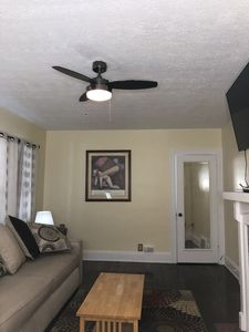 """Living room with 55"""" Smart Tv including DirecTv cable and high speed WiFi."""