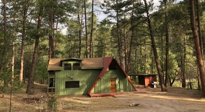 Photo for Enjoy this cabin in the woods, located close to midtown shopping and the casino.