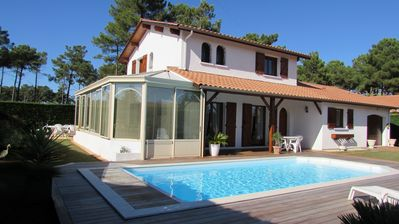 Photo for Very quiet and lovely villa, heated pool, garden, 5mn from beaches, 5 bicycles .