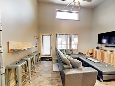 Living Area - Watch favorite shows on a wall-mounted TV in the living area.