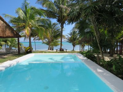 Photo for Beachfront To A Breathtaking Turquoise Caribbean secluded bay and close to town