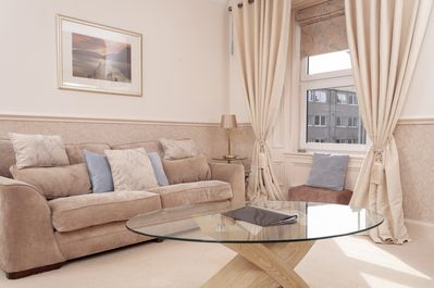 Living room with large 3 person sofa