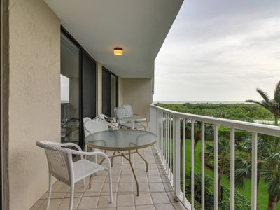 Photo for Elegant, waterfront condo w/ pool, shared hot tub, tennis access - walk to beach