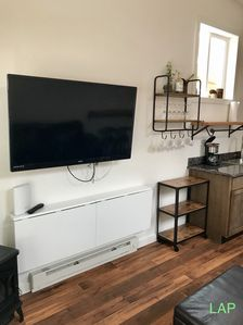 Flat screen TV with cable in living room