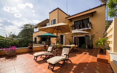 Photo for Exquisite Lakeside Villa, Staffed, amazing gardens, thermal water jacuzzi & pool