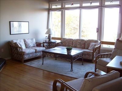 Open floor plan, comfortable living area with wood burning fireplace and TV