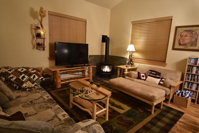 Living room. Cozy propane fireplace will keep you toasty.