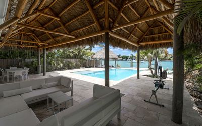 Photo for CARIBBEAN HOUSE: Secluded paradise, heated pool and walk to the beach!