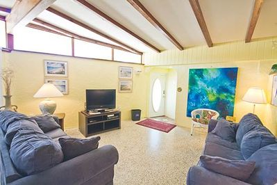 You'll love our living room's vaulted ceilings - Our spacious living room area features vaulted ceilings and beautiful Terrazo tile floors! Everyone will enjoy gathering together for fun and conversation!