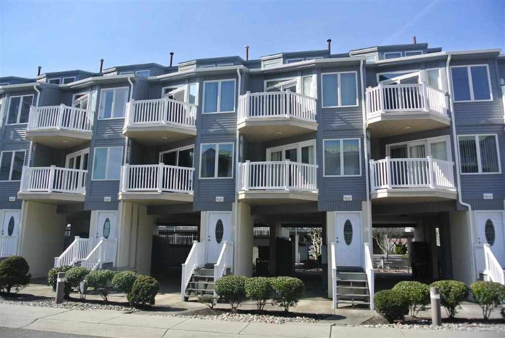 Recently renovated one block from beach three story for 3 story townhomes