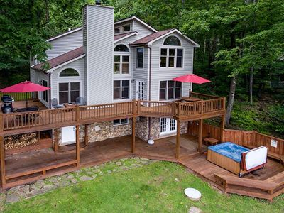 Dog friendly home with lake access, dock slip, game tables, grills and a hot tub!