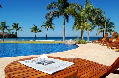 Photo for Five Star Luxury Beachfront villa in the Palms Residence Club