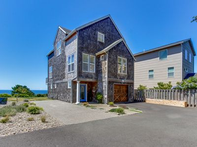 Photo for Pristine home w/ stunning views, short walk to beach & right in town