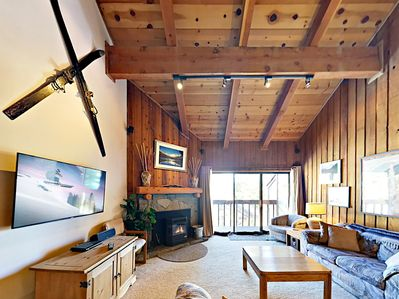 Living Room - Welcome to Mammoth Lakes! Cozy up by the pellet fireplace and watch your favorite Netflix shows on the flat screen TV. Complimentary Wi-Fi provided.