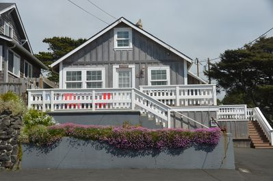 Front view of the cottage with the beach right across the street.
