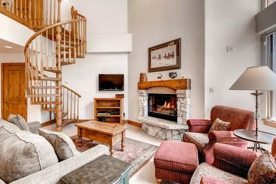 Relax and unwind with a movie or in front of the fireplace in the spacious living area. The actual layout of the unit may differ from the photos.