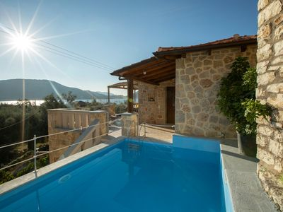 Photo for Watch the sunrise over the bay comfortable apartment with private pool, Nidri