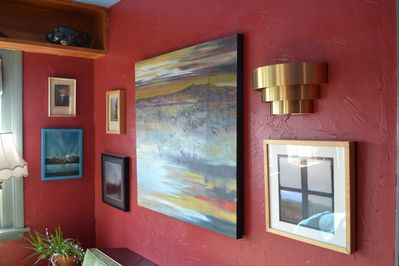 Artwork floods through the space, paintings, photography, oddities all around...