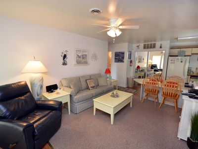 Photo for Traditional 2-bedroom bayfront condo with WiFi and indoor/outdoor pools located uptown and only 2 blocks to the beach!