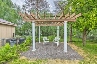 This home boasts a fenced backyard with a beautiful pergola.