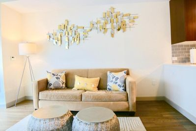 Bright, spacious living room features a sleeper sofa for additional guests and a Smart TV
