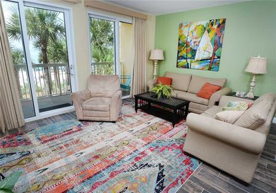 Family Room with a View - Enjoy sitting on the couch and playing a game of cards while listening to the breeze glide through the Florida palms.