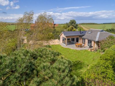 Photo for Peterstone Lodge, architecturally designed lodge with views across Holkham's ancient woodland