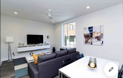 Photo for DISCOUNTED Chic Downtown Condo with luxury pool and dedicated parking