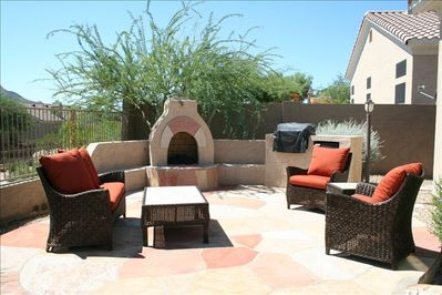 Outdoor Patio Seating area w/Gas Fireplace, Gas Grill and Mini-Fridge