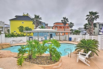 The property features access to community amenities including this outdoor pool!