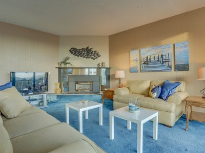 Photo for Gorgeous condo w/ lovely views and a shared pool & sauna, across from the beach!