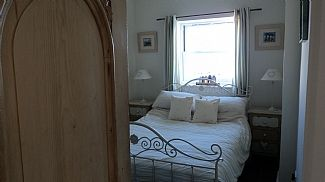 A light double bedroom with estuary view
