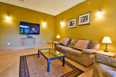 Kick back in the spacious downstairs lounge with pool table and private deck.