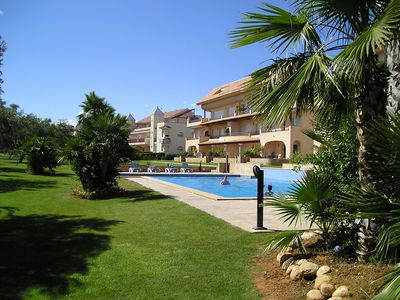 Photo for Modern duplex house overlooking communal pool and gardens at Golf Panoramica,