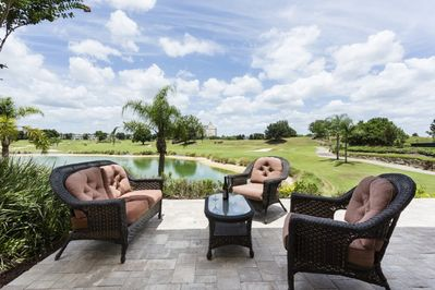 Patio overlooking lake & course.  Casual & dinning seating.  Gas Grill